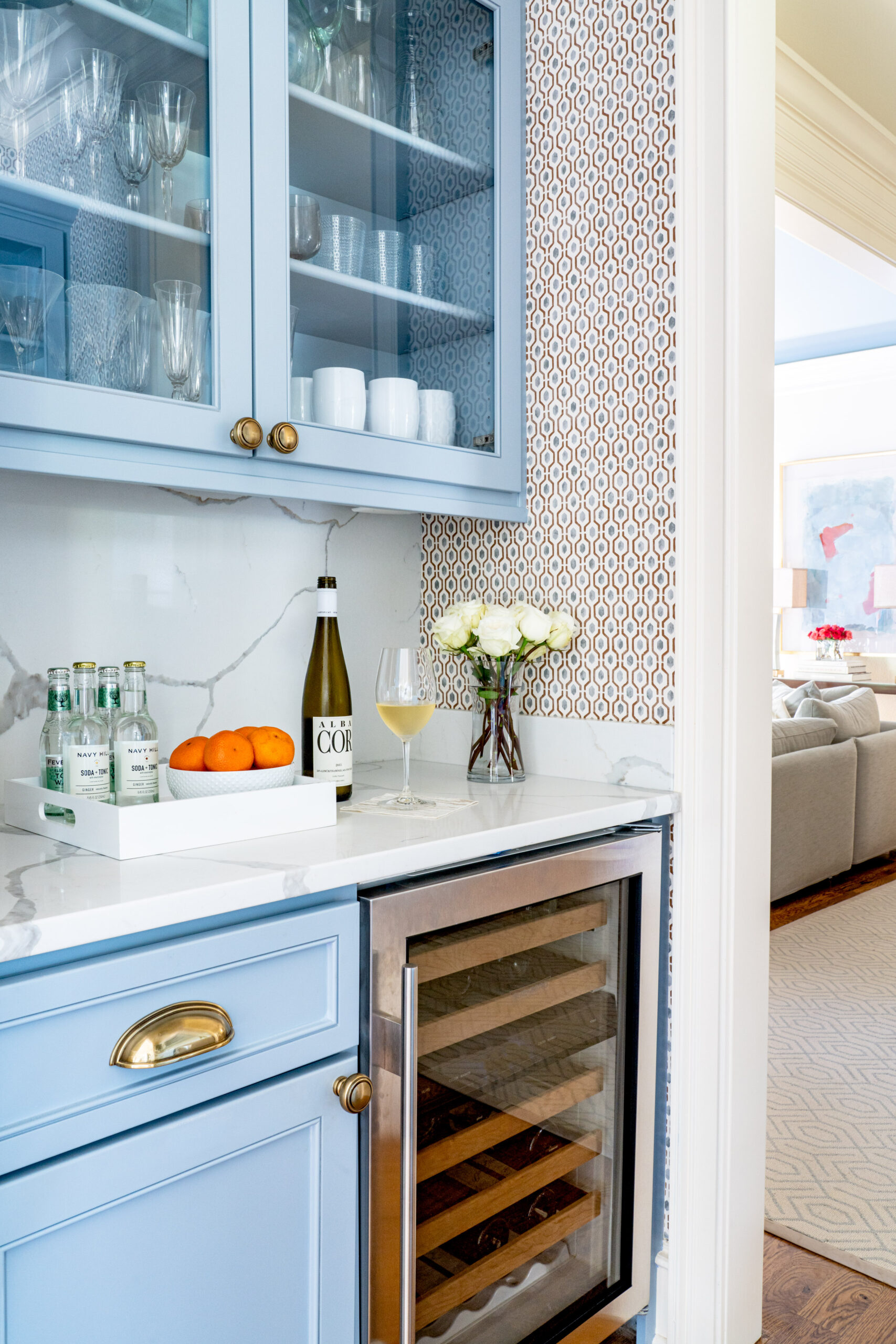 butler's pantry with blue cabinets and geometric wallpaper
