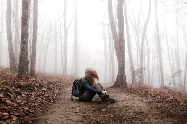physician heal thyself woman alone in woods with backpack