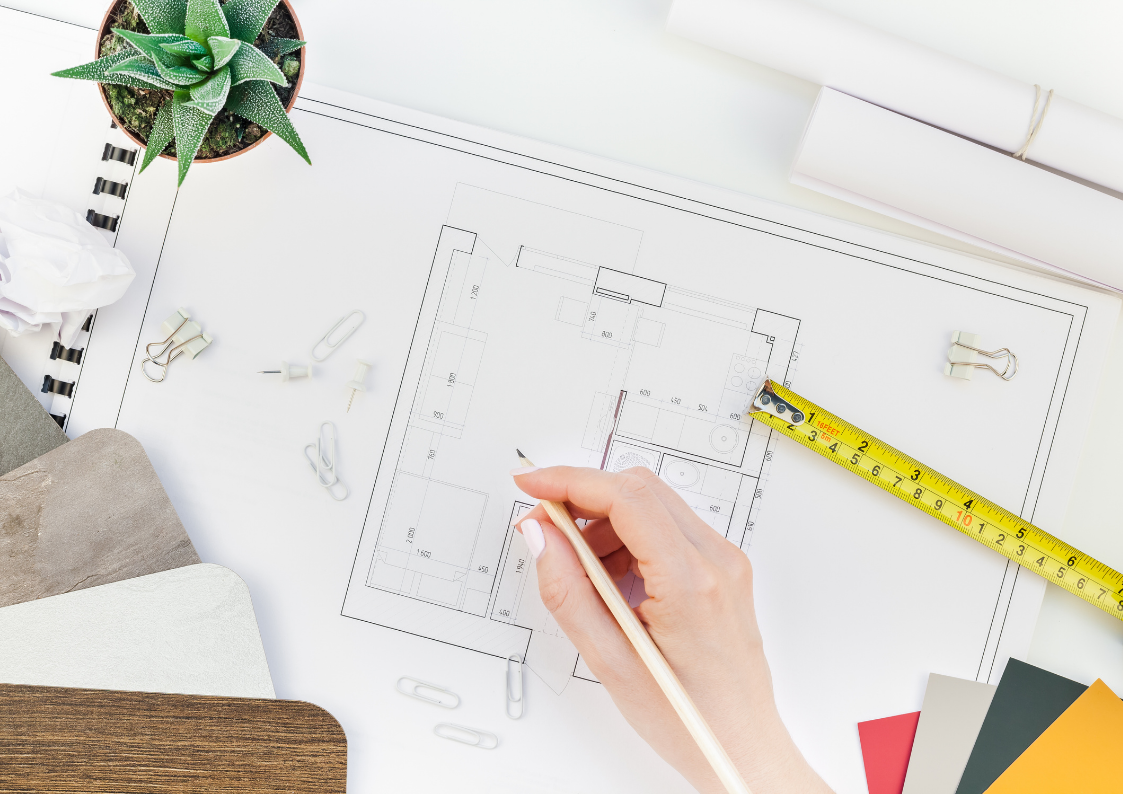 woman drawing a floor plan