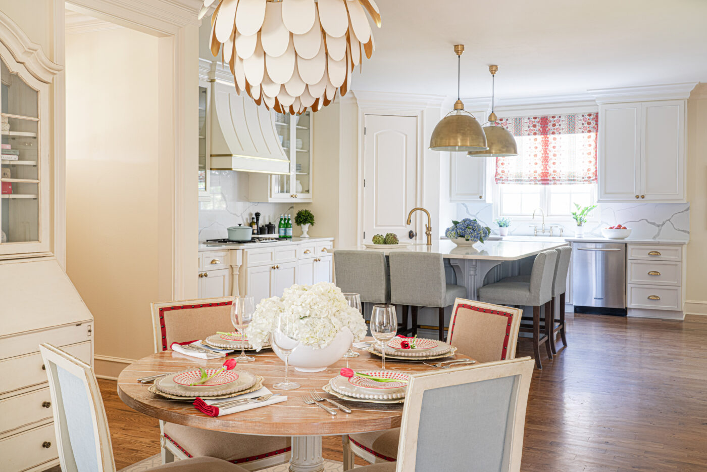 kitchen and breakfast nook with several wood finishes